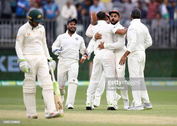Virat Kohli of India celebrates after Mohammed Shami of India took the wicket of Travis Head of Australia during day three of the second match in the...