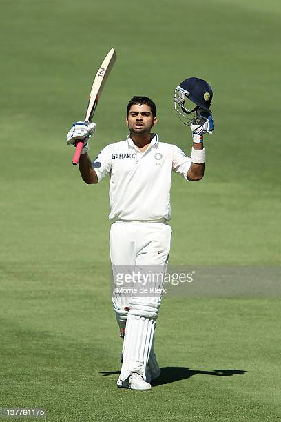 Virat Kohli of India celebrates after passing 100 runs during day three of the Fourth Test Match between Australia and India at Adelaide Oval on...