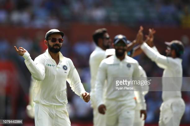 Virat Kohli of India celebrates after Ravi Ashwin of India took the wicket of Usman Khawaja of Australia during day four of the First Test match in...