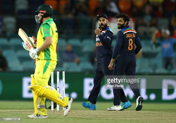 Virat Kohli of India celebrates after Ravindra Jadeja of India took the wicket of Aaron Finch of Australia during game three of the One Day...