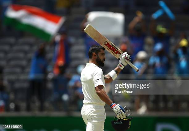 Virat Kohli of India celebrates after reaching his century during day three of the second match in the Test series between Australia and India at...