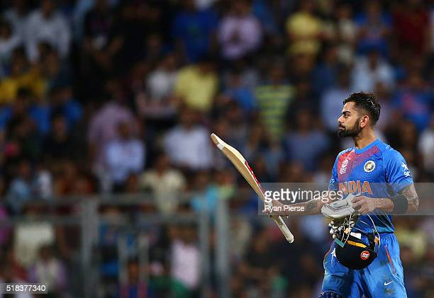Virat Kohli of India celebrates after reaching his half century during the ICC World Twenty20 India 2016 Semi Final match between West Indies and...