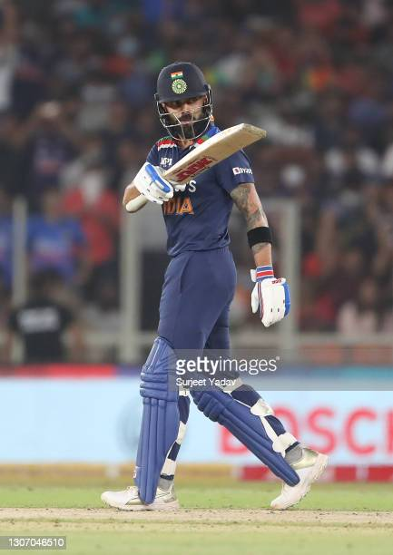 Virat Kohli of India celebrates after reaching their half century during the 2nd T20 International match between India and England at Narendra Modi...