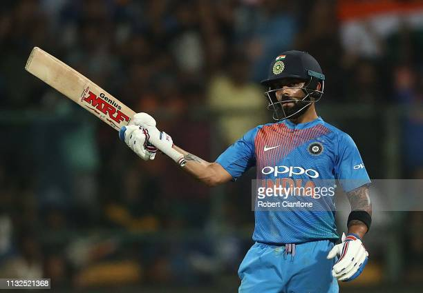 Virat Kohli of India celebrates after scoring his fifty runs during game two of the T20I Series between India and Australia at M Chinnaswamy Stadium...