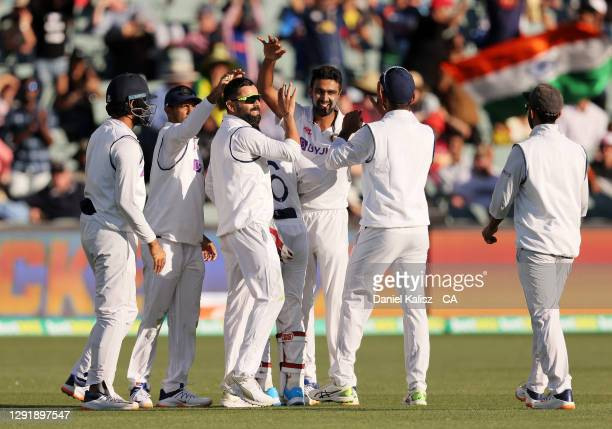 Virat Kohli of India celebrates after taking a catch to dismiss Cameron Green of Australia during day two of the First Test match between Australia...