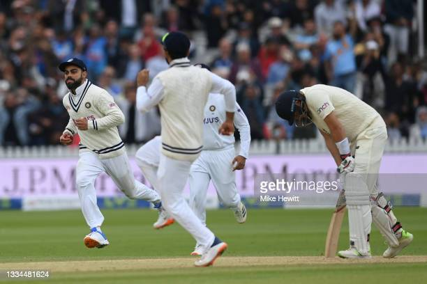 Virat Kohli of India celebrates after taking the catch to dismiss Joe Root of England during the Second LV= Insurance Test Match: Day Five between...