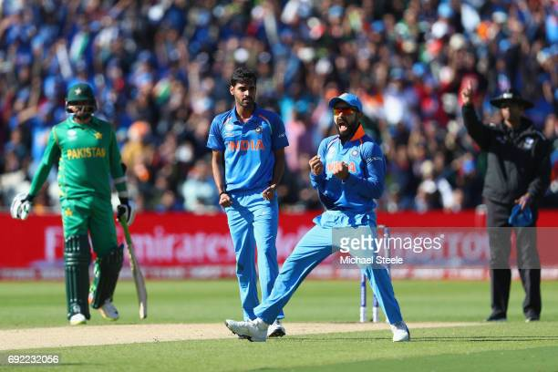 Virat Kohli of India celebrates as Bhuvneshwar Kumar captures the wicket of Ahmed Shehzad of Pakistan during the ICC Champions Trophy match between...