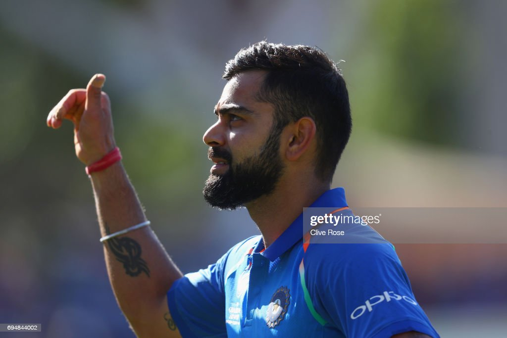 Virat Kohli of India celebrates as he leaves the field after the ICC Champions trophy cricket match between India and South Africa at The Oval in London on June 11, 2017