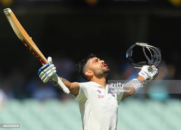 Virat Kohli of India celebrates as he reaches his century during day five of the First Test match between Australia and India at the Adelaide Oval on...