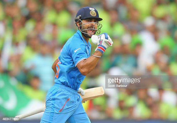 Virat Kohli of India celebrates as he reaches his century during the 2015 ICC Cricket World Cup match between India and Pakistan at Adelaide Oval on...