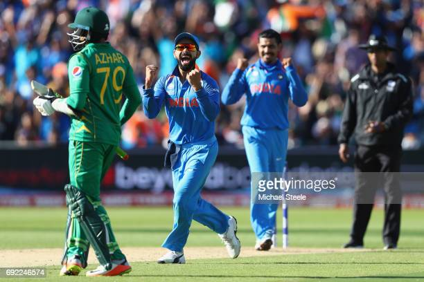 Virat Kohli of India celebrates as Ravindra Jadeja captures the wicket of Azhar Ali of Pakistan during the ICC Champions Trophy match between India...