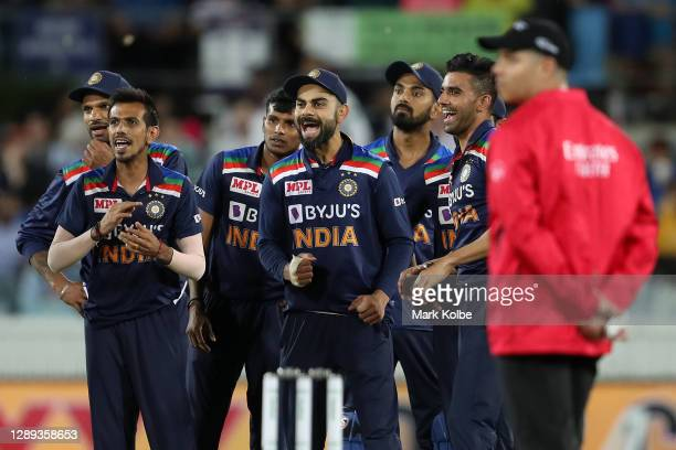 Virat Kohli of India celebrates as replays show the dismissal of Glenn Maxwell of Australia is confirmed as out during game one of the Twenty20...