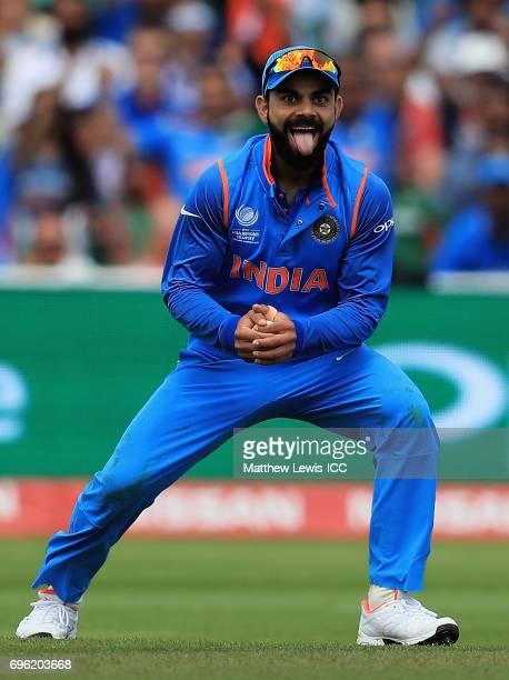 Virat Kohli of India celebrates catching Mushfiqur Rahim of Bangladesh off the bowling of Kedar Jadhav during the ICC Champions Trophy Semi Final...