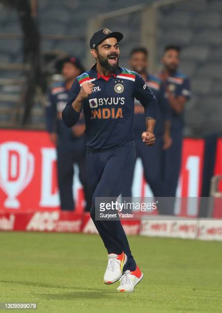 Virat Kohli of India celebrates following the 3rd One Day International match between India and England at MCA Stadium on March 28, 2021 in Pune,...