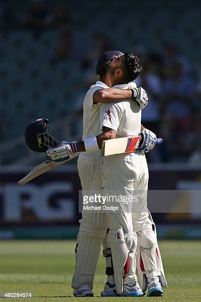 Virat Kohli of India celebrates his century and looks up to the sky with Karn Sharma during day three of the First Test match between Australia and...