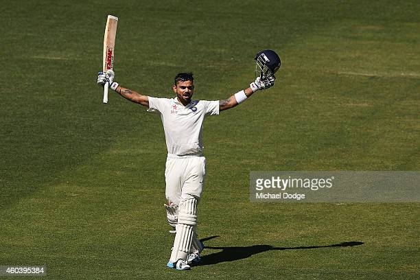 Virat Kohli of India celebrates his century during day five of the First Test match between Australia and India at Adelaide Oval on December 13, 2014...