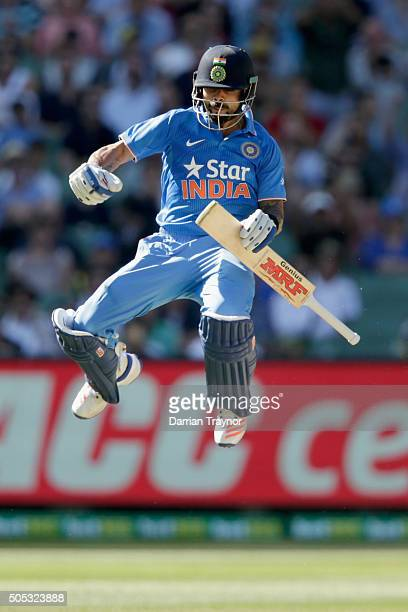Virat Kohli of India celebrates his century during game three of the One Day International Series between Australia and India at Melbourne Cricket...