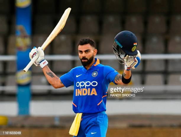 Virat Kohli of India celebrates his century during the 3rd ODI match between West Indies and India at Queens Park Oval, Port of Spain, Trinidad and...