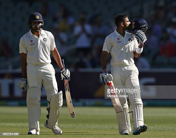 Virat Kohli of India celebrates his century with Karn Sharma during day three of the First Test match between Australia and India at Adelaide Oval on...