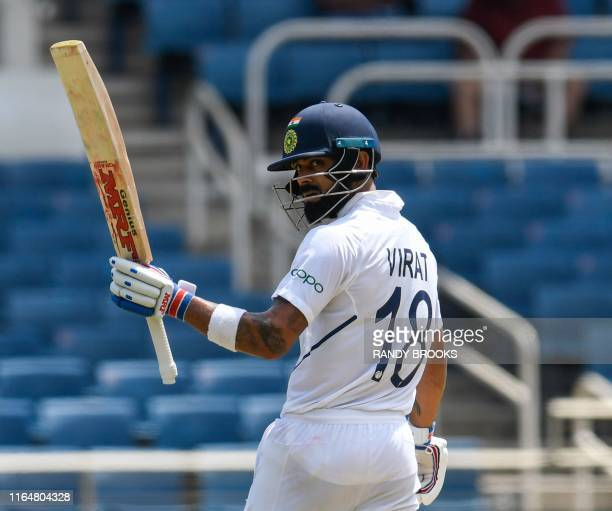 Virat Kohli of India celebrates his half century during day 1 of the 2nd Test between West Indies and India at Sabina Park, Kingston, Jamaica, on...