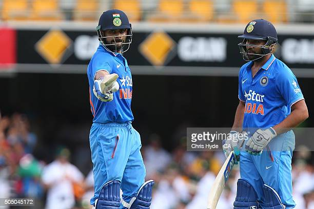 Virat Kohli of India celebrates his half century with team mate Rohit Sharma during game two of the Victoria Bitter One Day International Series...