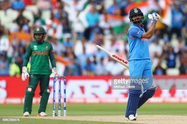 Virat Kohli of India celebrates hitting the winning runs and victory by 9 wickets during the ICC Champions Trophy SemiFinal match between Bangladesh...