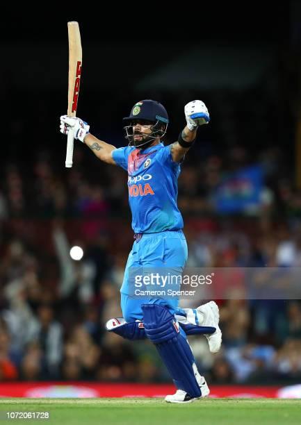 Virat Kohli of India celebrates hitting the winning runs during the International Twenty20 match between Australia and India at Sydney Cricket Ground...