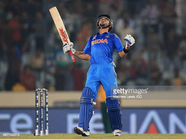 Virat Kohli of India celebrates hitting the winning runs during the ICC World Twenty20 Bangladesh 2014 Semi Final match between India and South...