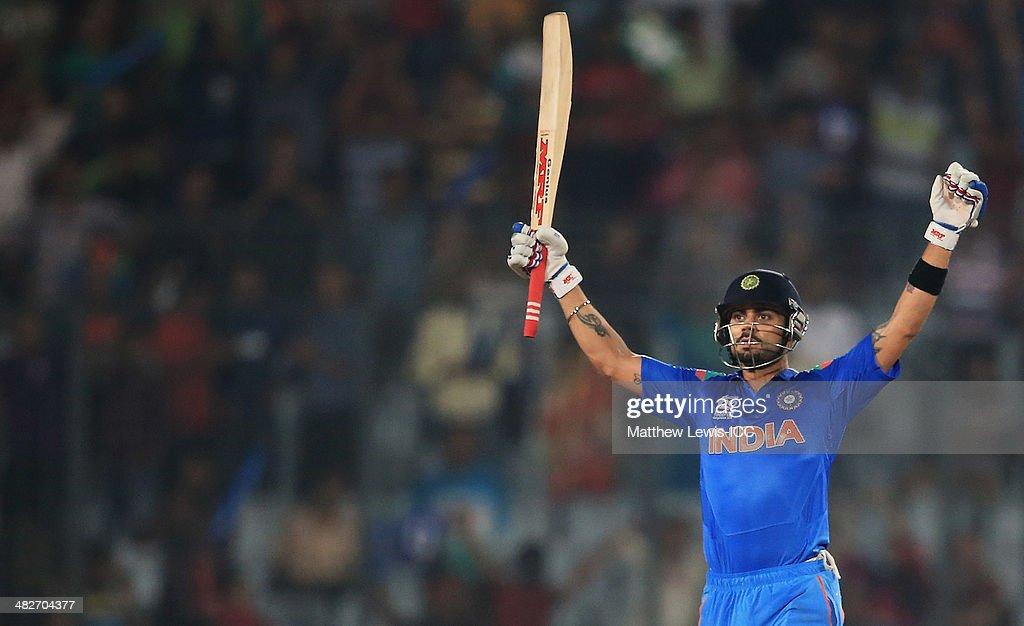 Virat Kohli of India celebrates hitting the winning runs during the ICC World Twenty20 Bangladesh 2014 Semi Final match between India and South Africa at Sher-e-Bangla Mirpur Stadium on April 4, 2014 in Dhaka, Bangladesh.