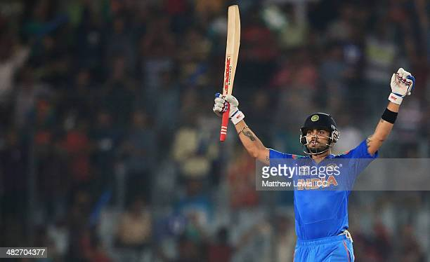 Virat Kohli of India celebrates hitting the winning runs during the ICC World Twenty20 Bangladesh 2014 Semi Final match between India and South...