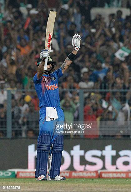 Virat Kohli of India celebrates making 50 runs during the ICC World Twenty20 India 2016 match betweenPakistan and India at Eden Gardens on March...