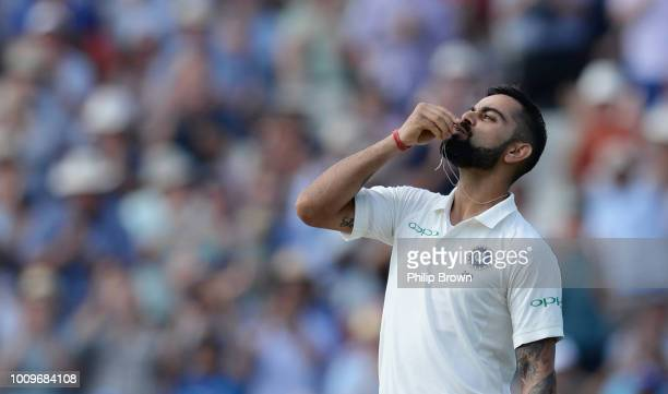 Virat Kohli of India celebrates reaching his century during the second day of the 1st Specsavers Test Match between England and India at Edgbaston on...