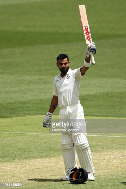 Virat Kohli of India celebrates scoring a century during day three of the second match in the Test series between Australia and India at Perth...