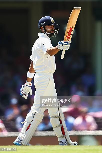 Virat Kohli of India celebrates scoring fifty runs during day three of the Fourth Test match between Australia and India at Sydney Cricket Ground on...