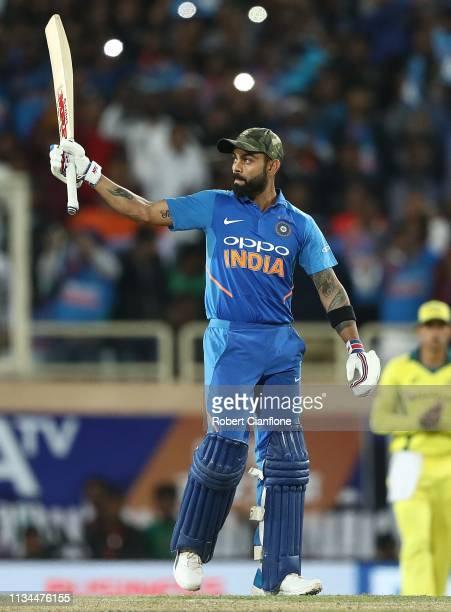 Virat Kohli of India celebrates scoring his century during game three of the One Day International series between India and Australia at JSCA...