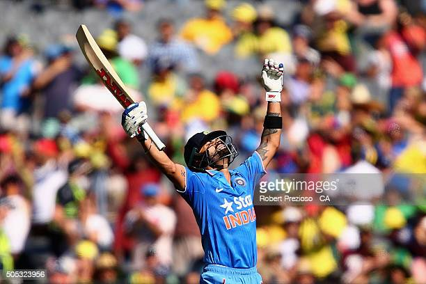 Virat Kohli of India celebrates scoring his century during game three of the One Day International Series between Australia and India at Melbourne...