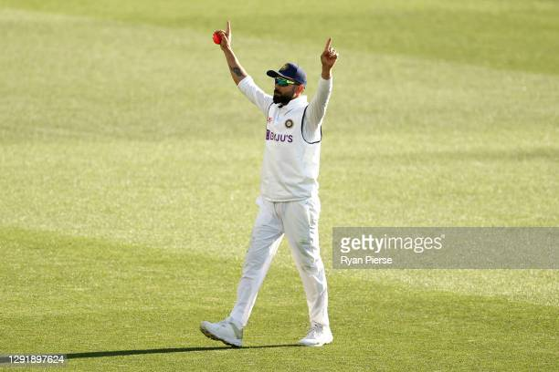 Virat Kohli of India celebrates taking the catch to dismiss Cameron Green of Australia during day two of the First Test match between Australia and...
