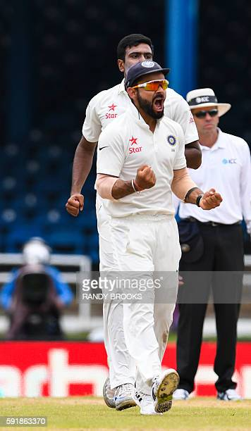 Virat Kohli of India celebrates the dismissal of Darren Bravo of West Indies during day 1 of the 4th and final Test between West Indies and India at...