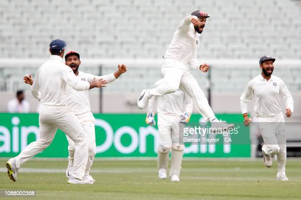 Virat Kohli of India celebrates the last wicket as India defeat Australia on day five of the Third Test match in the series between Australia and...