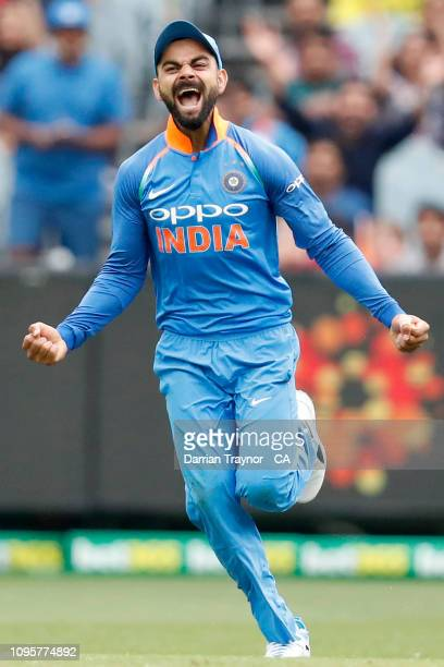 Virat Kohli of India celebrates the wicket of Aaron Finch of Australia during game three of the One Day International series between Australia and...