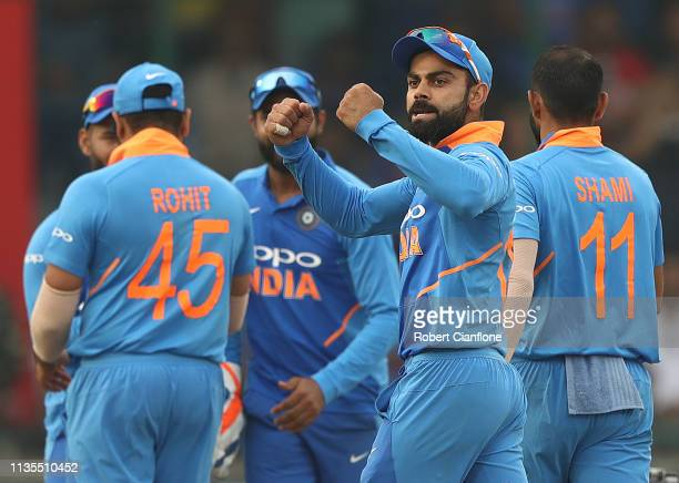 Virat Kohli of India celebrates the wicket of Alex Carey of Australia during game five of the One Day International series between India and...
