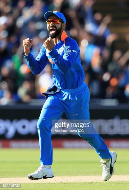 Virat Kohli of India celebrates the wicket of Azhar Ali of Pakistan after he was caught by Hardik Pandya during the ICC Champions Trophy match...