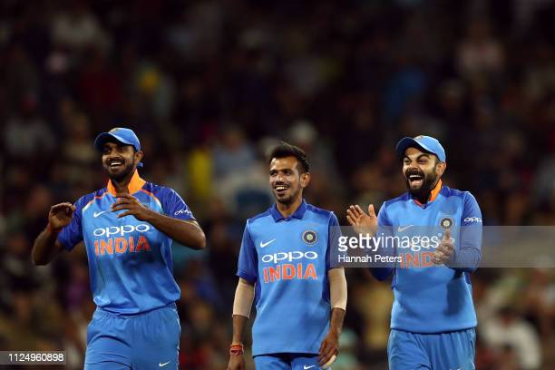 Virat Kohli of India celebrates the wicket of Colin de Grandhomme of the Black Caps with his team during game two of the One Day International Series...