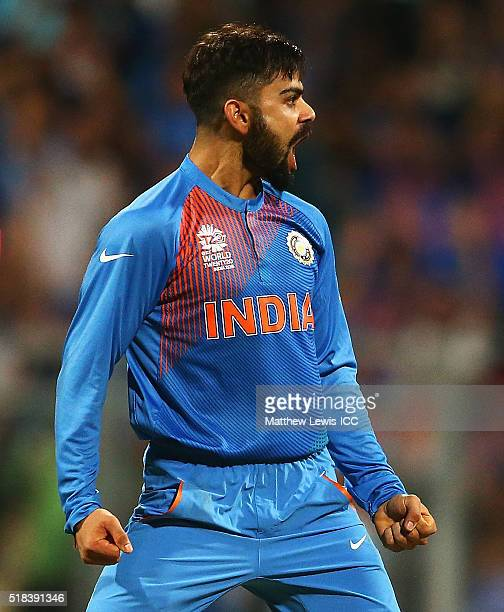 Virat Kohli of India celebrates the wicket of Johnson Charles of the West Indies after he was caught by Rohit Sharma of India during the ICC World...
