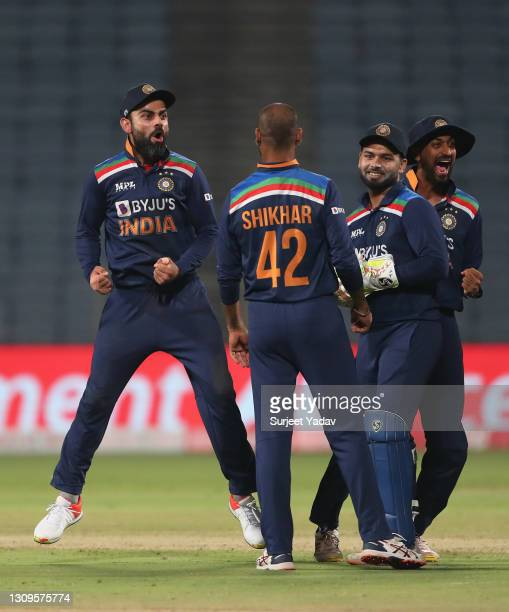 Virat Kohli of India celebrates the wicket of Jos Buttler of England, dismissed by team mate Shardul Thakur during the 3rd One Day International...