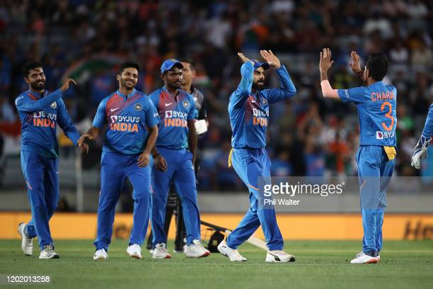 Virat Kohli of India celebrates the wicket of Kane Williamson of New Zealand during game two of the Twenty20 series between New Zealand and India at...