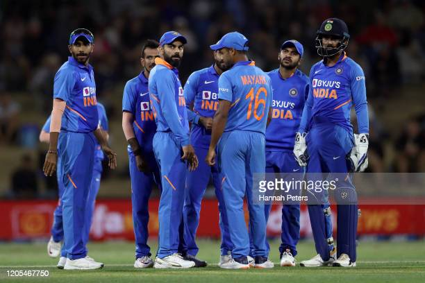 Virat Kohli of India celebrates the wicket of Kane Williamson of the Black Caps with his team during game three of the One Day International Series...