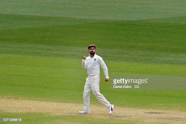 Virat Kohli of India celebrates to Indian fans during day five of the First Test match in the series between Australia and India at Adelaide Oval on...
