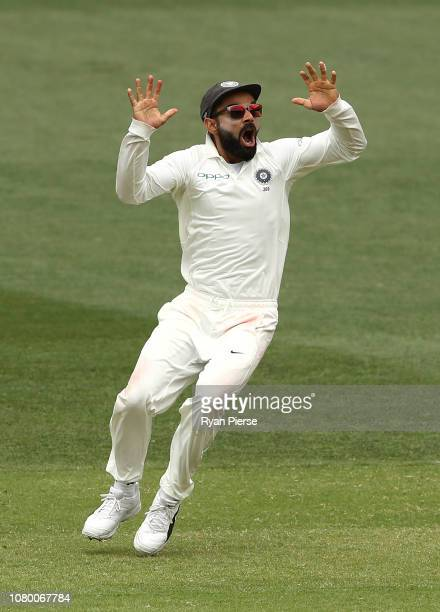 Virat Kohli of India celebrates victory during day five of the First Test match in the series between Australia and India at Adelaide Oval on...