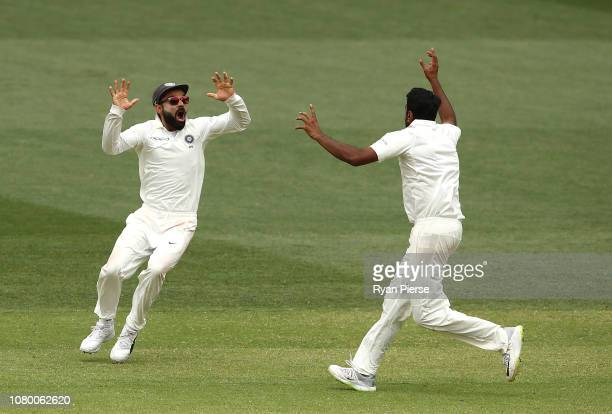Virat Kohli of India celebrates victory with Ravi Ashwin of India during day five of the First Test match in the series between Australia and India...